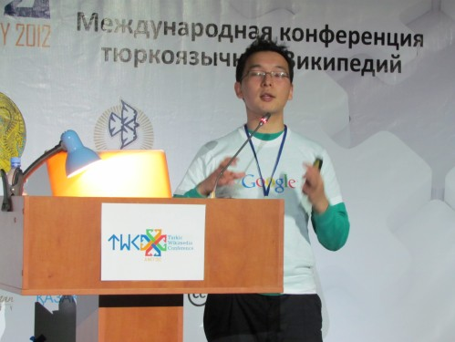 Tilek Mamutov, giving a talk about Google Translate