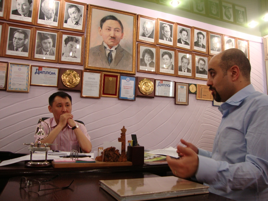 Meeting the manager of Bichik, the national book publisher. On the wall - portraits of notable Sakha writers.